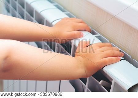 Child Getting Warmer Up Her Hands Over An Electric Radiator Of Heating At Home.problems With Home He