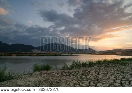 Dry Soil And Lake Of Mengkuang Dam In Evening During Project To Expand Mengkuang Dam.