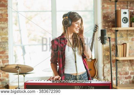 Home Music Studio, Beautiful Woman Recording Music, Singing And Playing Piano While Standing In Loft