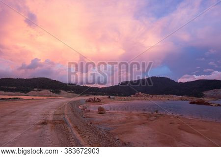The Dry Land Of Mengkuang Dam With Dramatic Sky.