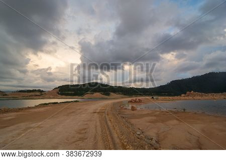 Colourful Cloud Of Dry Land Of Mengkuang Dam During Expansion Work.
