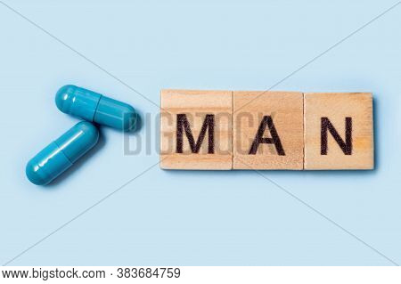 Two Blue Capsules And The Inscription Man. Pills For Mens Health And Sexual Energy On An Isolated Ba