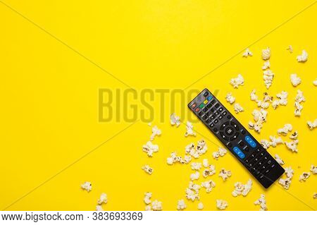 Tv Remote Control, Tv Tuner Or Audio System And Popcorn On A Yellow Background. Concept Series, Film