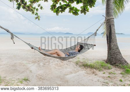 Beautiful Woman Sleeping On Hammock On The Beach, Moment From The Vocation.