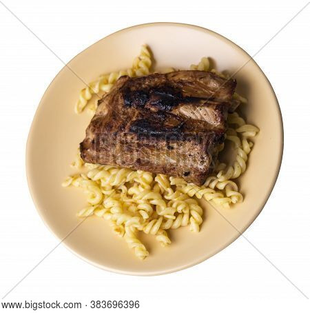 Grilled Pork Ribs With Pasta. Grilled Pork Ribs On Beige Plate Isolated On White Background. Grilled