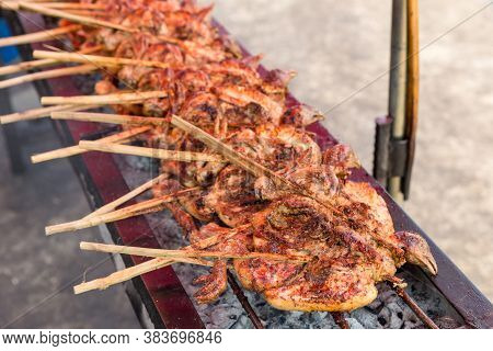 Roast Or Grilled Chicken Thai Style, Barbecue Chicken. Grilled Chicken On The Stove In Thai Street F