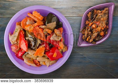 Vegetable Stew On Blue Grey Wooden Background. Stew In Bulgarian On Purple Plate Top View
