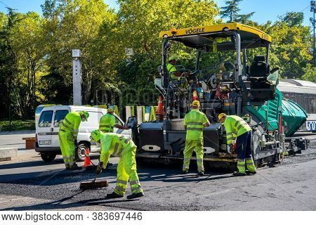 Valladolid, Spain - 02 September 2020: Public Workers Resurfacing A Road With Tar, Valladolid Spain