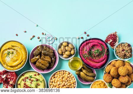 Mediterranean Appetizer Concept. Arabic Traditional Cuisine. Middle Eastern Meze With Pita, Olives,
