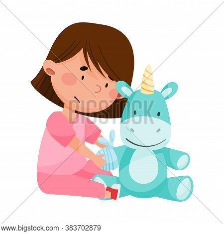 Careful Little Girl In Medical Wear Treating Fluffy Toy Unicorn Vector Illustration
