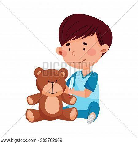Careful Little Boy In Medical Wear Treating Teddy Bear Vector Illustration