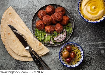 Traditional Middle Eastern Dish Falafel Served With Fresh Bread Pita, Hummus And Olives. Arab Or Med