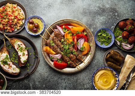 Delicious Meat Kebab With Fresh Vegetable Salad Served With Variety Of Middle Eastern Dishes And App