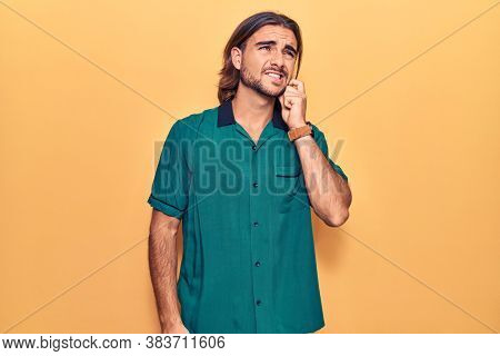 Young handsome man wearing casual clothes thinking concentrated about doubt with finger on chin and looking up wondering