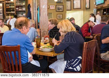 New Orleans, Louisiana/usa - 5/7/2017: Elderly Couple And Patrons Dining At Mandina's Restaurant