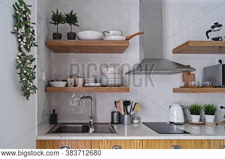 Modern Kitchen Interior With White Brick Tile Wall In Scandinavian Style, Wooden Shelf And Tableware