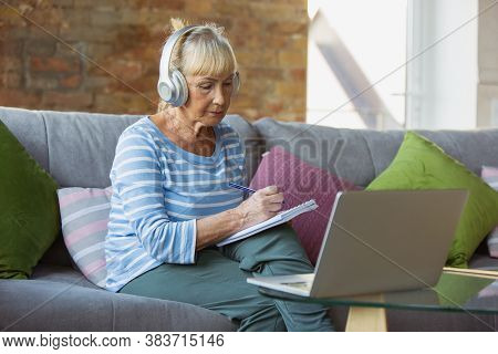Watching Online Courses. Senior Woman Studying At Home, Getting Online Courses, Self-development. Ca