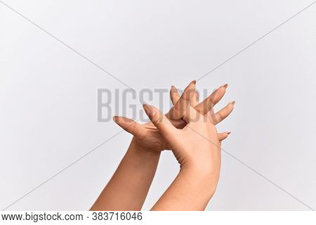 Hand of caucasian young woman stretching with fingers intertwined, hands together and fingers interlocked