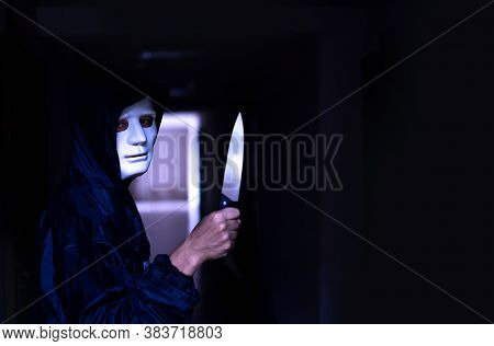 Murder Wear The Mask Standing In The Old Apartment, Kill And People Concept - Criminal Or Murderer W