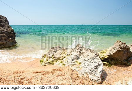 Transparent Clear Sea With A Sandy Shore. The Shore Of The Black Sea. Holidays On The Shore
