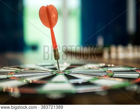 Red Dart Arrow Hit In The Target Center Of Dartboard, Winner Concept, Goal Concept