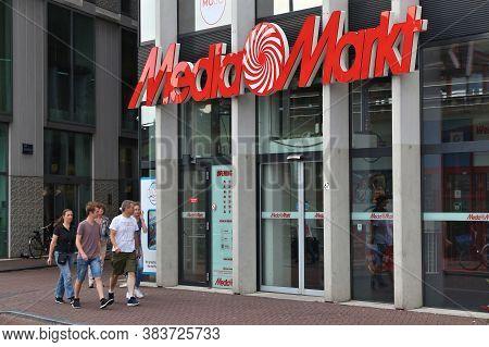 Amsterdam, Netherlands - July 8, 2017: People Walk By Media Markt Store In Amsterdam. Media Markt Is