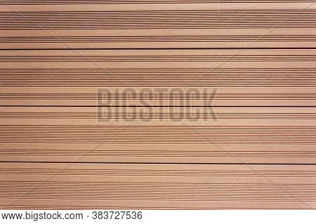 Background Of Light Brown Boards With Grooves Made Of Vertical Tongue And Groove Boards