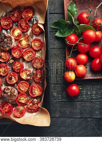 Oven-baked Cherry Tomatoes And Fresh Tomatoes On A Wooden Table.