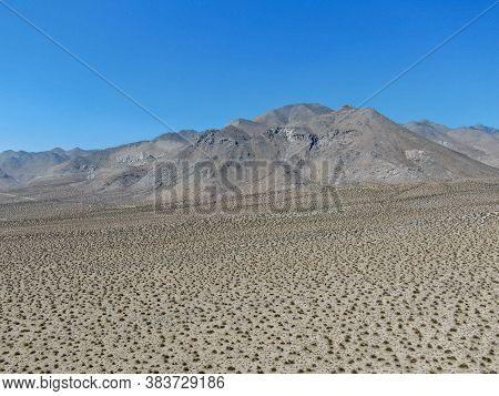 Aerial View Of Desert Hills Under Blue Sky In Californias Mojave Desert, Near Ridgecrest. Small Rock