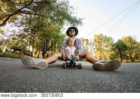 Young Man Skater Resting Sitting On Skateboard With Girl