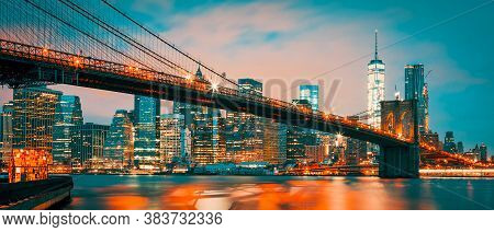 Panoramic View Of New York City Manhattan Midtown At Dusk With Brooklyn Bridge