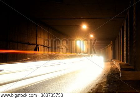 Old Damp Tunnel With Water Flowing From The Wall. Tunnel With Light Trails.