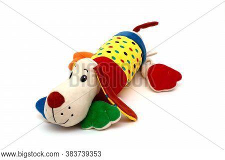 Dog Plush Doll Isolated On White Background. Plush Dog Doll On A White Background. Color Soft Toy.