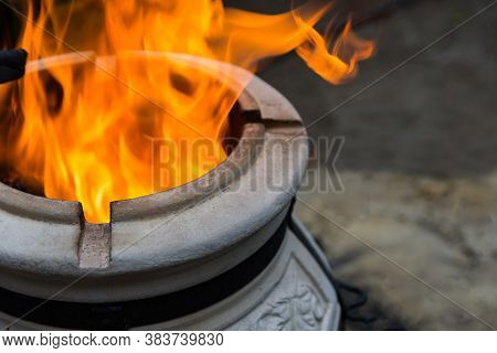 Firewood Is Being Burned In Tandoor Heating It Before Roasting Barbeque At Night. Tandoor Is A Speci