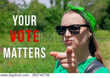 Girl Shows A Finger And Looks At The Camera Your Vote Matters Text Sign. Vote Elections.political Ch