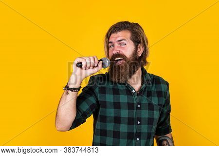 Happy To Sing. Male Karaoke Singer. Mature Charismatic Male Vocalist. Guy With Beard Singing In Micr