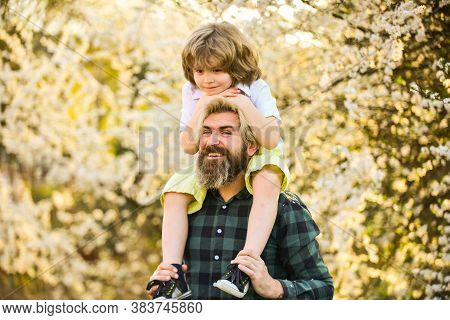 Having Fun Together. Love Concept. Cheerful Father Playing With Child In Park. Handsome Dad With Lit