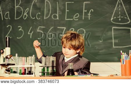 Back To School. Pupil Looking Through Microscope . Microscope At Lab. Small Boy At Science Camp. Stu