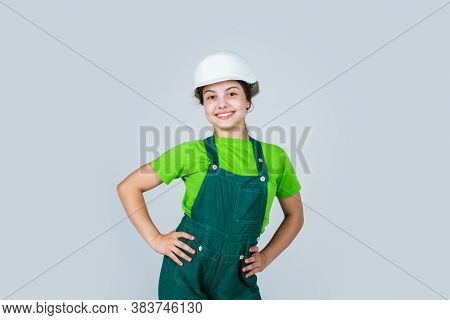 Assistant. Portrait Of Little Girl With Hard Hat. Little Girl In Hard Hat Play In Workshop. Child Pr
