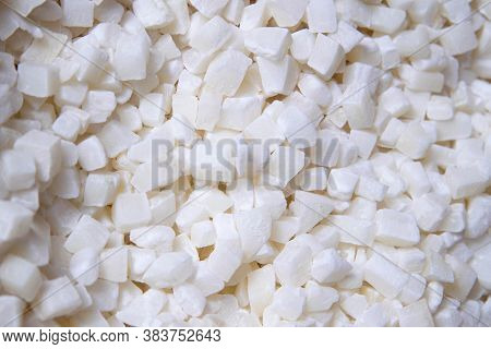 Sweet Dried Cubes Of Coconut Fruit, Dried Coconut Pieces Background. Top Views, Close-up.