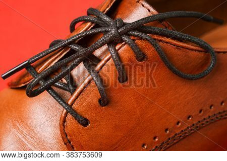 Leather Shoes Close-up. Details Of Mens Clothing. Mens Shoes Are Brown With Black Laces