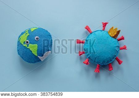Model Of Earth And Coronavirus On Blue Background. Pandemic Cov Infection On Planet. Toys Captive Ea