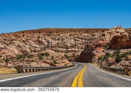 Long Desert Highway California. Road Against The High Rocks. Hilly Country Road