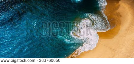 Panorama Of A Clean Beach. Aerial Photography Of A Clean Sandy Beach. Beautiful Beach With Yellow Sa