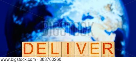 Deliver. Wooden Blocks With The Inscription Deliver On The Background Of The Planet Earth