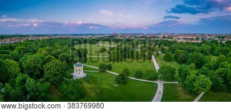 Aerial View Over Munich And Its Popular Englischer Garten, Very Green And Symbolic Healthy Park Of T