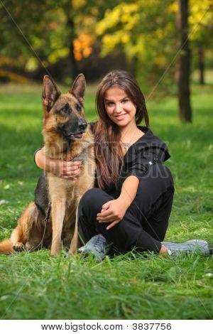 Smiling Teenager Hugging A Dog