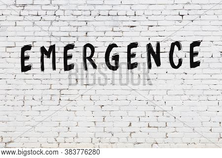 White Brick Wall With Inscription Emergence Handwritten With Black Paint