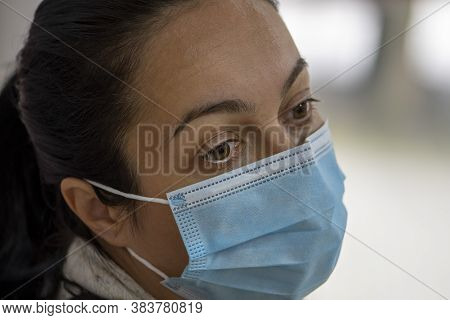 Portrait Of A Woman 35-40 Years Old With Dark Hair In A Medical Mask, Tired Appearance, Close-up, Se