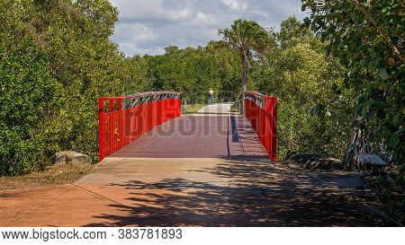 Designated Walking Track And Bridge With Bright Red Side Rails For Public Access Through Bushland